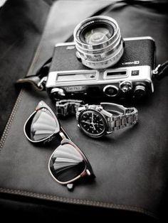 sunglasses, nice watch, and a camera