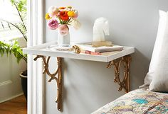 This pair of iron brackets became a bedside table in just a few minutes. Find out how here: https://www.onekingslane.com/live-love-home/a-stylish-solution-vintage-hardware-3-ways/