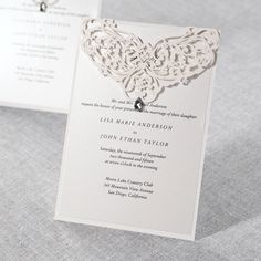 This enchanting invitation is designed with intricate damask patterns. || @bwedding
