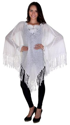 A gorgeous, fringed poncho sweater in winter white. Pair with wool tights or leggings for a cozy look. Cozy Winter Outfits, Winter Clothes, Poncho Sweater, Knitted Poncho, Wool Tights, Khaki Green, Winter White, Winter Fashion, Leggings