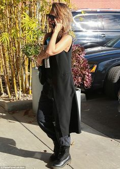 All black everything: The 34-year-old actress wore a chic long waistcoat and baggy pants with Dr. Marten boots