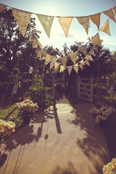 "Beautiful hessian and lace bunting which we could make and hang, this would enable you to ""zone"" your areas as the loft is such a large space separating out a reception area from your dining tables. We could make some bunting bespoke to you"