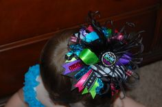 Colorful Over the top hair bow with Bottle Cap  http://www.etsy.com/listing/89024615/colorful-over-the-top-hair-bow-with?ref=sr_gallery_15_search_query=over+the+top+hair+bow_view_type=gallery_ship_to=US_page=7_search_type=all
