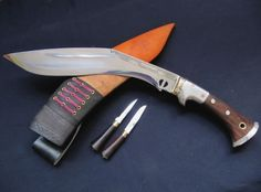 Gurkha Kukri - the two small knives are the Karda which serves as a small cutting knife. The other knife is called a Chakmak. It is blunt on both sides and it works like a knife sharpener. THIS IS AN AWESOME NEW VERSION OF A TRADITIONAL KUKRI. one helluva limb detachment device