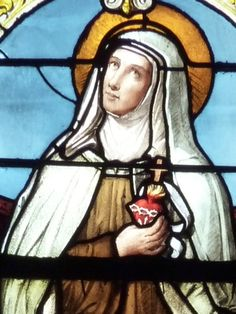 detail of a stained glass window of Blessed Marie of the Incarnation; date and artist unknown; Saint-Maclou, Pontoise, France; photographed on 2 June 2011 by GFreihalter; swiped from Wikimedia Commons; click for source image