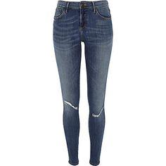 Mid wash Amelie superskinny reform jeans $84.00