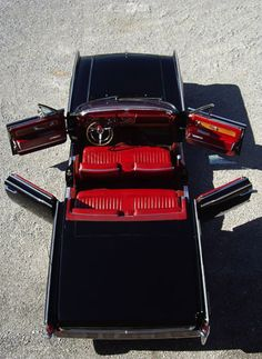 Vintage Lincoln. Suicide doors and red leather interior. Grandpa drove one just like this when I was a child.