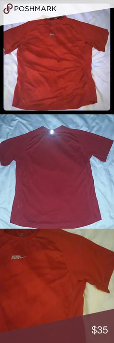 Men's Nike Running Shirt L New condition  Athletic Tshirt Sweat wicking Reflective  Fine black print on front Plain red on back Mesh side panels under arms 1st photo is a similar style same color red same brand different emblem placement, on the top I'm selling Nike emblem is in middle top of chest see other photos   Men's lululemon Nike Shirts Tees - Short Sleeve