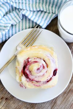 Raspberry Sweet Rolls Recipe on twopeasandtheirpod.com Serve these amazing sweet rolls at your holiday brunch!