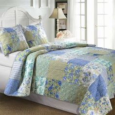 Bedding set with a paisley patchwork motif. Product:  Twin: 1 Quilt and 1 standard sham  Full/Queen: 1 Quilt and 2 standard shams King: 1 Quilt and 2 king shams Construction Material: CottonColor: Jade and multiFeatures:   Squares of updated floral and stripe patterns  Double diamond stitching enhance the quilts softness  Reverses to a coordinating floral print  Oversized for better mattress coverage    Dimensions:  Standard Sham: 20 x 26 each King Sham: 20 x 36 each