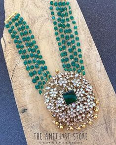 Emerald beads necklace designs with lakshmi pendnat , ganesh pendant multi layered emerald long chain designs Pearl Necklace Designs, Gold Earrings Designs, Beaded Jewelry Designs, Gold Jewellery Design, Bead Jewellery, Diamond Jewellery, Silver Jewellery Indian, Indian Wedding Jewelry, Bridal Jewelry