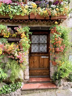 European photo of door surrounded by flowers in Antibes(Provence), France by Dennis Barloga | Photos of Europe: Fine Art Photographs by Dennis Barloga