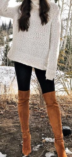 knitted white sweater and brown leather knee-high boots