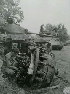 August 16th 1944, Sgt Orell Crocker,Troy ,AL of an armored division maintenance force works over a medium tank motor while other members of the unit go to work on the turret of another tank in the back ground. This is a rare photo of members of 2nd Armored Divisions maintenance Battalion. The area is Le Teilleul France , some might remember Hurricane from the 66th Armored Regiment had photos of it taken in the same area. thats the info that comes with the photo