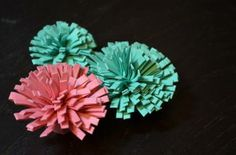 "fringe scissor flowers 2-1/2 x 11"" strips folded in half to 1-1/4"". add sticky strip along long edge and roll-up"