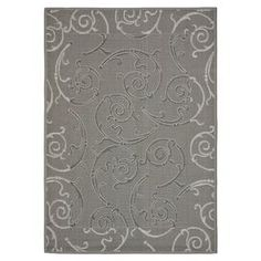 """Indoor/outdoor rug with a scrolling vine motif.  Product: RugConstruction Material: PolypropyleneColor: Anthracite and light greyFeatures:  Made in TurkeyMachine madeSuitable for indoor and outdoor use Dimensions: 5'3"""" x 7'7""""Note: Please be aware that actual colors may vary from those shown on your screen. Accent rugs may also not show the entire pattern that the corresponding area rugs have.Cleaning and Care: Sweep, vacuum or rinse off with a garden hose"""