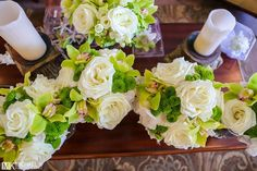 White roses with green accents - What a beautiful pairing!