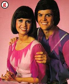 Donnie and Marie - I watched them on TV, I had their Barbie Dolls, I had their records, and it was the first concert I ever went to (I got to go up on stage, but got lost coming off stage because it was a rotating stage!)!!!!