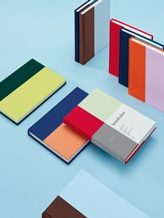"""How do you find a new idea for paper products in the ever-evolving digital world? We take a stroll through our bookshelf! Based on the bookbinding practice of half-linen or half-leather binding, we developed a contemporary and sleek product line for the brand Semikolon over the last 2 years. Divided in a """"golden ratio"""" and wrapped in a fresh two-tone color scheme, it presents notebooks, photo albums and boxes for storing those things closest to your heart. Those things you want to keep."""