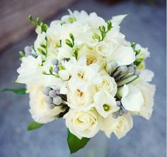 #bouquet featuring white roses, callas and freesia with accents of silver brunia pods