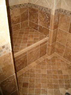 pictures of tile showers  | also slope towards the shower floor.