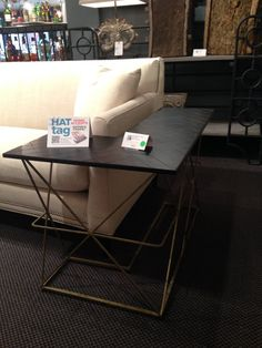 A #HATtag for this chic and functional wraparound sofa table by @gabbydecor #hpmkt