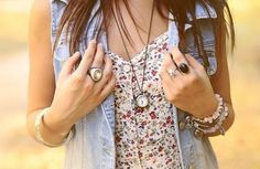 Pair your floral tank with a denim vest!  Ignore the arm party and watch necklace!!
