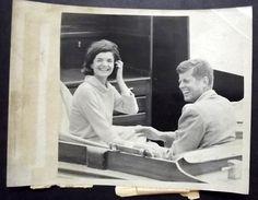 jackie winking a board of victura with jack Photo was taken July 19 1960 aboard the Kennedy Yacht Marlin. ❤✿❤❃❤☀❤❃❤✿❤ http://en.wikipedia.org/wiki/John_F._Kennedy     http://en.wikipedia.org/wiki/Jacqueline_Kennedy_Onassis