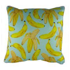 Kräftige Farben und ein lebendiger Bananen-Print verleihen diesem Kissen einen heiteren Look und bereichern jedes Interieur mit tropischem Flair.