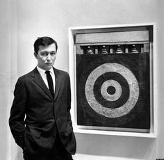 Artist Jasper Johns, standing beside his mixed-media painting Target. (Photo by Ben Martin//Time Life Pictures/Getty Images)