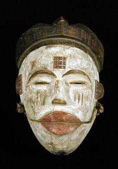 """Ogoni Mask with hinged jaw Ogoni people, Nigeria wood w/ kaolin, mineral pigments, string (10 1/2""""h. x 7 1/4""""w. x 4 1/2""""d.)"""