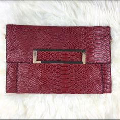 RED FAUX SNAKESKIN CLUTCH Red snakeskin flat clutch with gold chain detachable strap. Price firm unless bundled. 12 1/2 in x 8 in worn once for a photoshoot. Boutique Bags Clutches & Wristlets