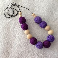 Purple with a passion - my crochet beads alongside natural wooden beads.