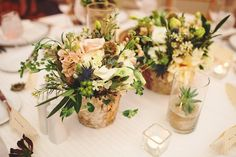 woodland wedding arrangements and succulents in glass vases