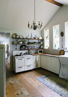 Open shelves & a chandelier... via Small World