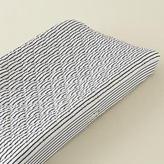 Blue stripe changing pad cover via Land Of Nod.
