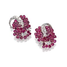 PAIR OF PLATINUM, GOLD, RUBY AND DIAMOND EARCLIPS, OSCAR HEYMAN & BROTHERS Designed as leaves set with round rubies weighing approximately 16.70 carats, and round and baguette diamonds wieghing approximately 1.90, unsigned.