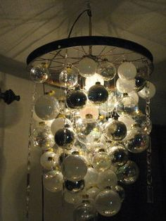 Too Christmas-y for all year round? What do you think?    Light feature made from christmas ornaments and a bike wheel... awesome! ~ Di Very cool and easy enough to put together!
