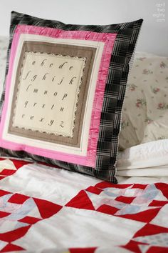 This adorable alphabet pillow cover has been created with a panel by Moda with contrasting taupe, pink and black fabrics to create a striking