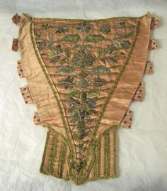 Stomacher made in 1740-1760. Silk satin, laced and embroidered with a floral design in silk and metal thread.