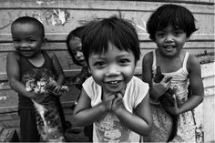 Philippines Happy children. Taken without them posing. I think that is the challenge. You can see that their cuteness are so natural and flow from their innocent hearts. These are the tough and forever happy children of Smoky Mountain. - © Mio Cade
