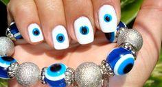 Unhas decoradas contra mau olhado e inveja. Unhas de olho grego.