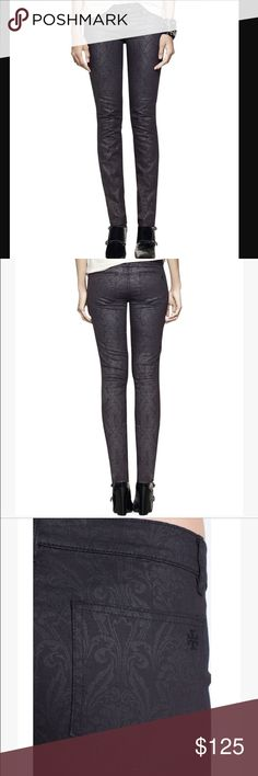 Tory Burch Black Denim Floral Lattice A tonal, slightly coated pattern adds a sense of regalness to the lean, modern form of stretch-woven jeans. Zip fly with button closure. Back patch pockets. 70% cotton, 27% polyester, 3% spandex. Machine wash cold. By Tory Burch Tory Burch Jeans Skinny