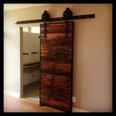 Industrial Mushroom Wood Sliding barn door. Want this for the office/living room.