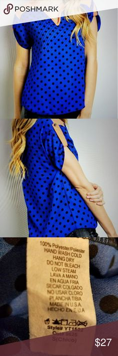 SUPER CUTE POLKA DOT TOP BLUE WITH BLACK POLKA DOT TOP WITH CONTRASTED SOLID SHOULDER PANELS AND A V NECKLINE MADE IN USA 100 PERCENT  POLYESTER  HAS A SL8GHT SHEERNESS TO  IT PLEASE ASK SIZING QUESTIONS PRIOR TO PURCHASE PRICE FIRM UNLESS BUNDLED SORRY NO TRADES Tops Blouses