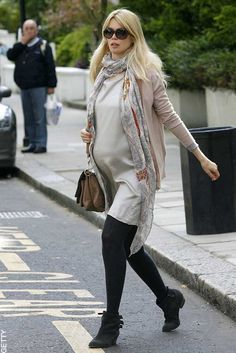 Claudia wears a beautiful soft silk dress. This elegant dress is worn with a long knit cardigan and loose scarf  for a chic casual daytime look.