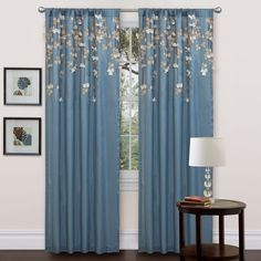 Add a touch of class to your living space with this faux silk drop curtain panel. This curtain panel is made of faux silk polyester and has a stunning embroidered hanging flower design that includes rod slits on the top and bottom.