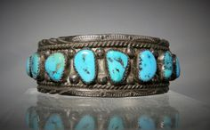 Total weight is 48.50 grams Single row of 9 Kingman Turquoise cabochons. The bracelet measures 5.15 inches not including the gap. The gap