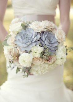 Gorgeous white bouquet topped with succulents. Photo by Sarah Kate, Photographer. #wedding #bouquet #succulents