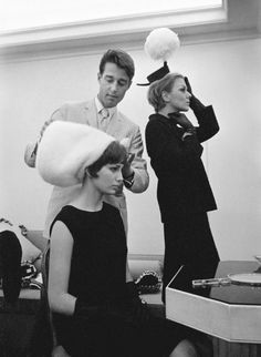 """A hat"", he said philosophically, puffing on a thin cigarillo, ""is a head-covering which is supposed to make you glamorous, exciting and more interesting than anyone else. ""- Halston"